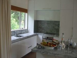 Engineered stone kitchen benchtop and surround