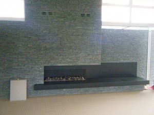 Modern Stone Fire Surround - Full Wall Fireplace and Hearth
